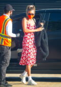 Hailey Bieber looks pretty in a red floral print dress as she arrives for dinner at Nobu in Malibu, California