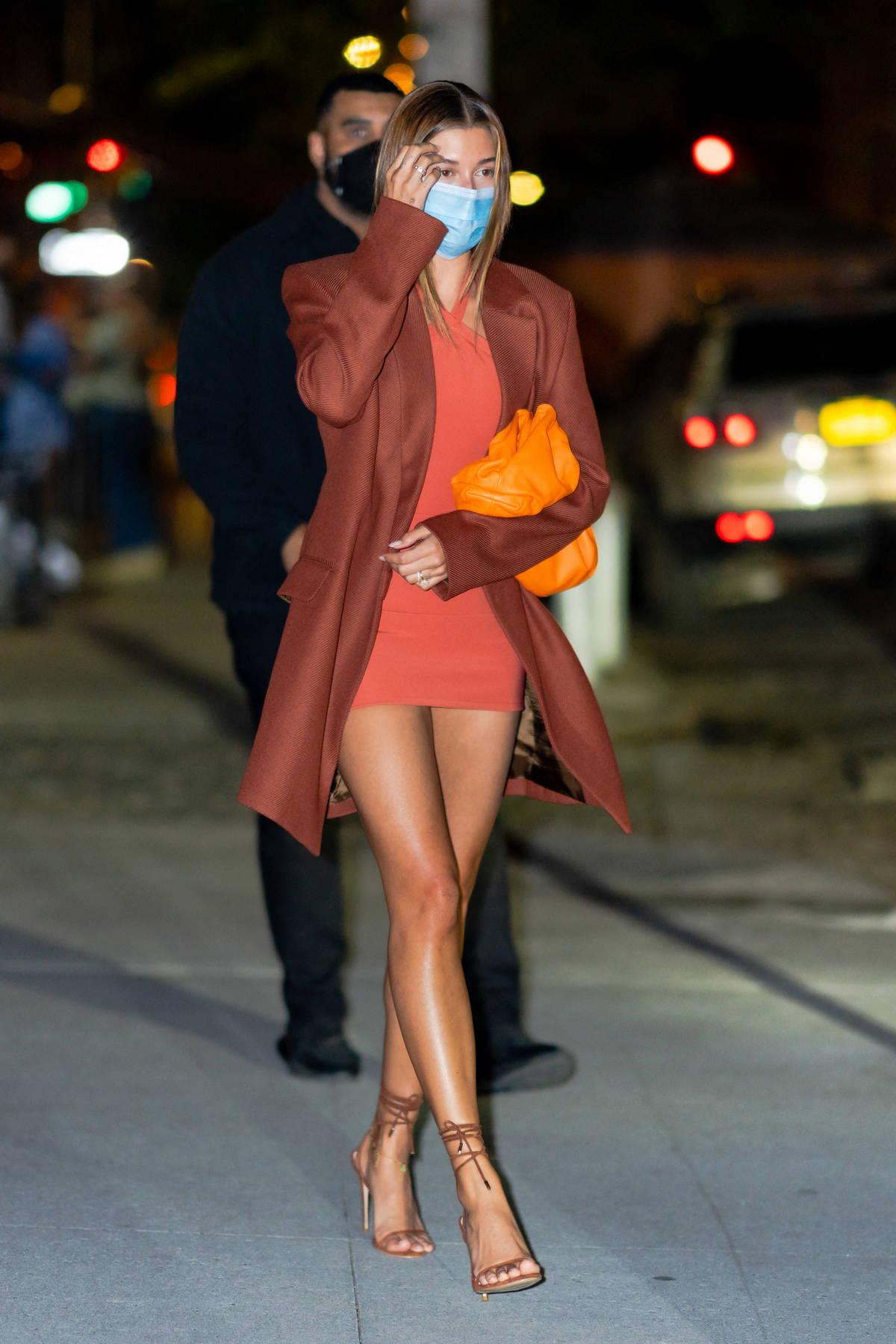 Hailey Bieber looks stunning in burnt orange as she leaves the Zero Bond Restaurant in New York City