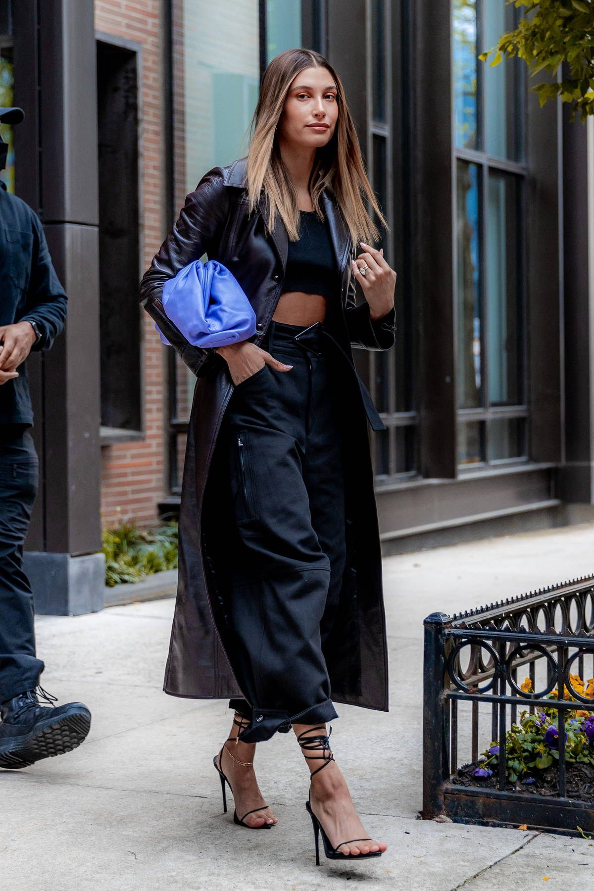 Hailey Bieber looks stylish in a leather trench coat with an all-black ensemble as she leaves her apartment in Brooklyn, New York