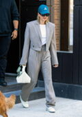 Hailey Bieber rocks a grey pinstriped suit and sneakers as she leaves her apartment in Brooklyn, New York