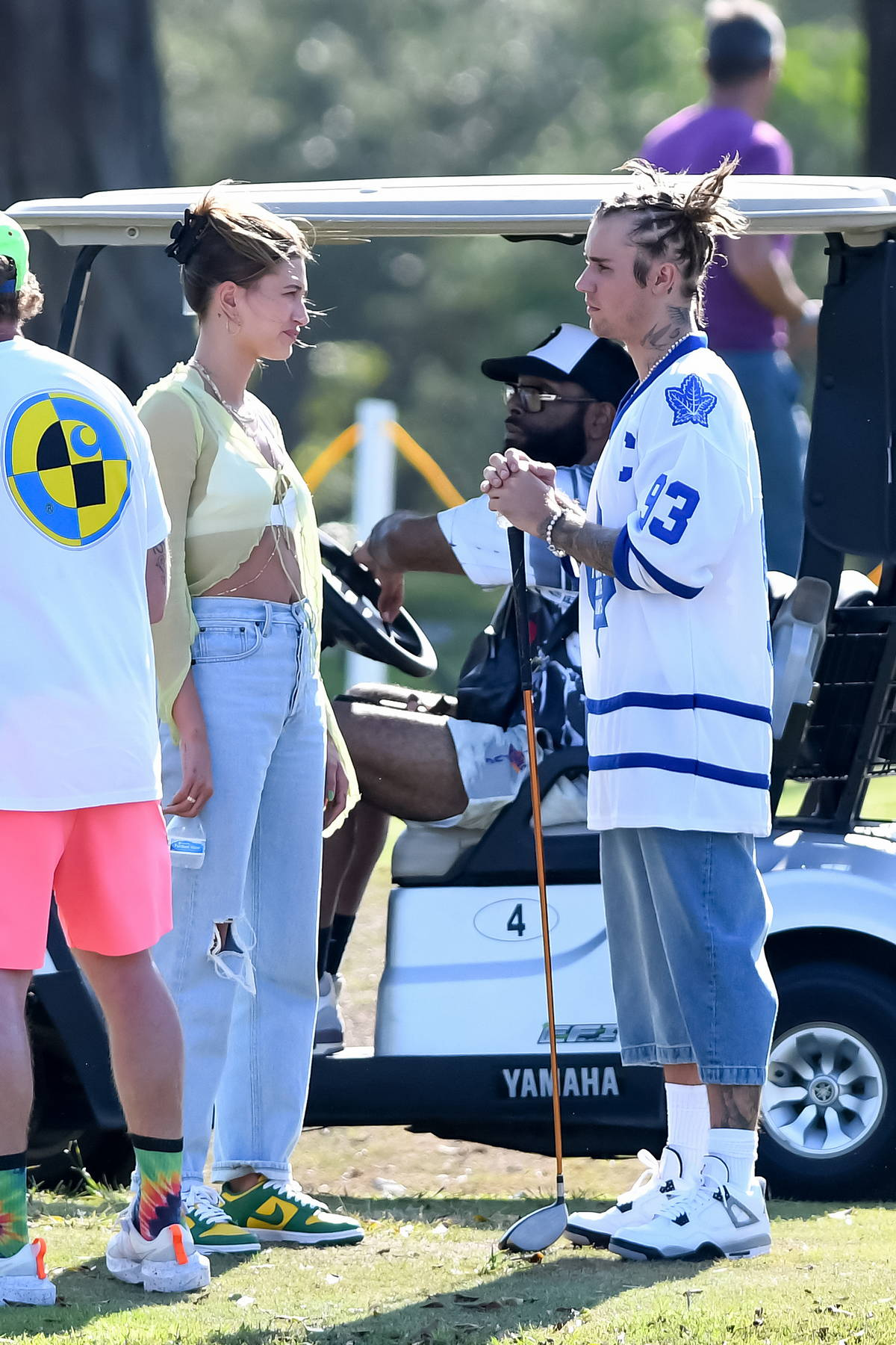 Hailey Bieber wears a sheer top while visiting Justin Bieber on the set of a music video in Miami, Florida