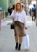 Hilary Duff dons a floral print dress with a white cardigan during a shopping trip on Rodeo Drive in Beverly Hills, California