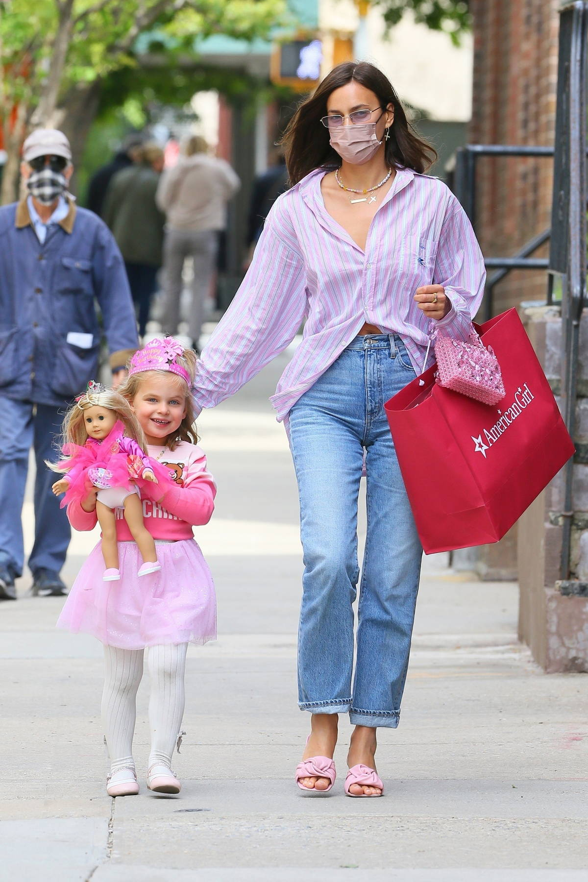 Irina Shayk heads home with her daughter Lea after attending a birthday party at 'American Girl' in New York City