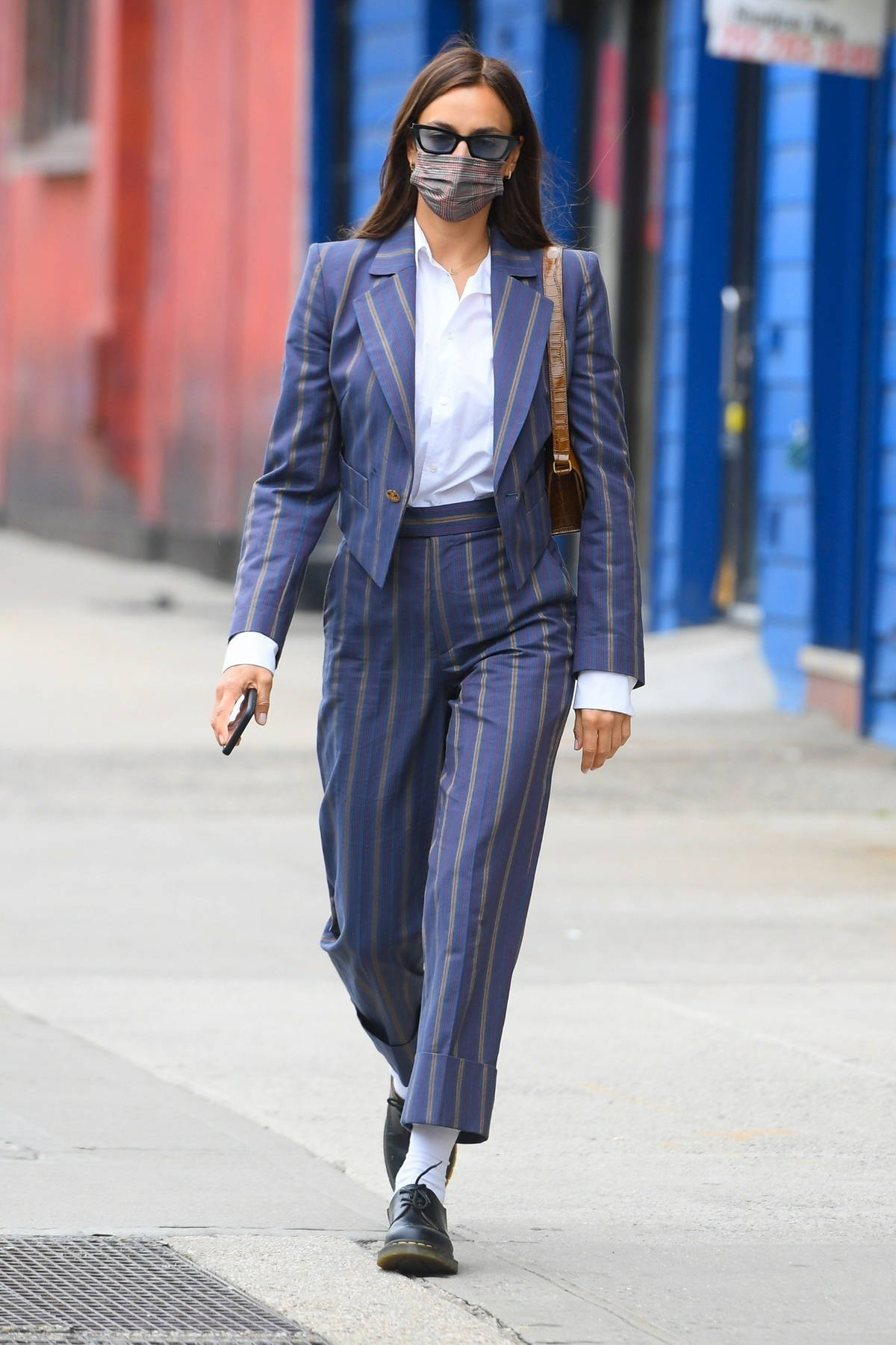Irina Shayk looks sharp in a blue pinstriped suit as she steps out with her daughter in Manhattan, New York City