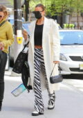 Irina Shayk looks stylish in an off-white trench coat and Zebra print pants as she steps out in New York City