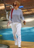 Isla Fisher and Sacha Baron Cohen enjoy a park outing with their family in Sydney, Australia