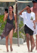 Jasmine Tookes and Kelsey Merritt seen enjoying a beach day with their boyfriends while vacationing in Tulum, Mexico