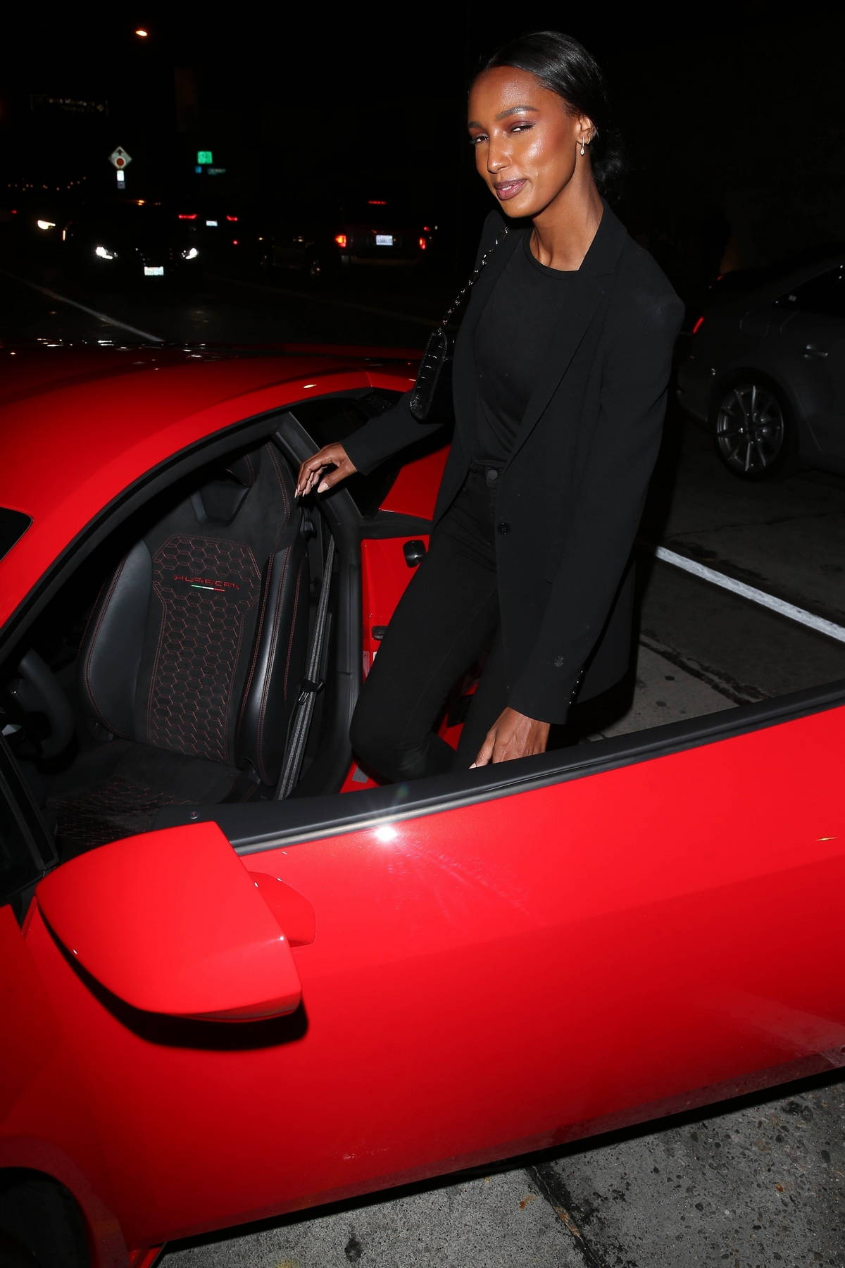 Jasmine Tookes drives off in her new red hot Lamborghini after dinner at Craig's in West Hollywood, California