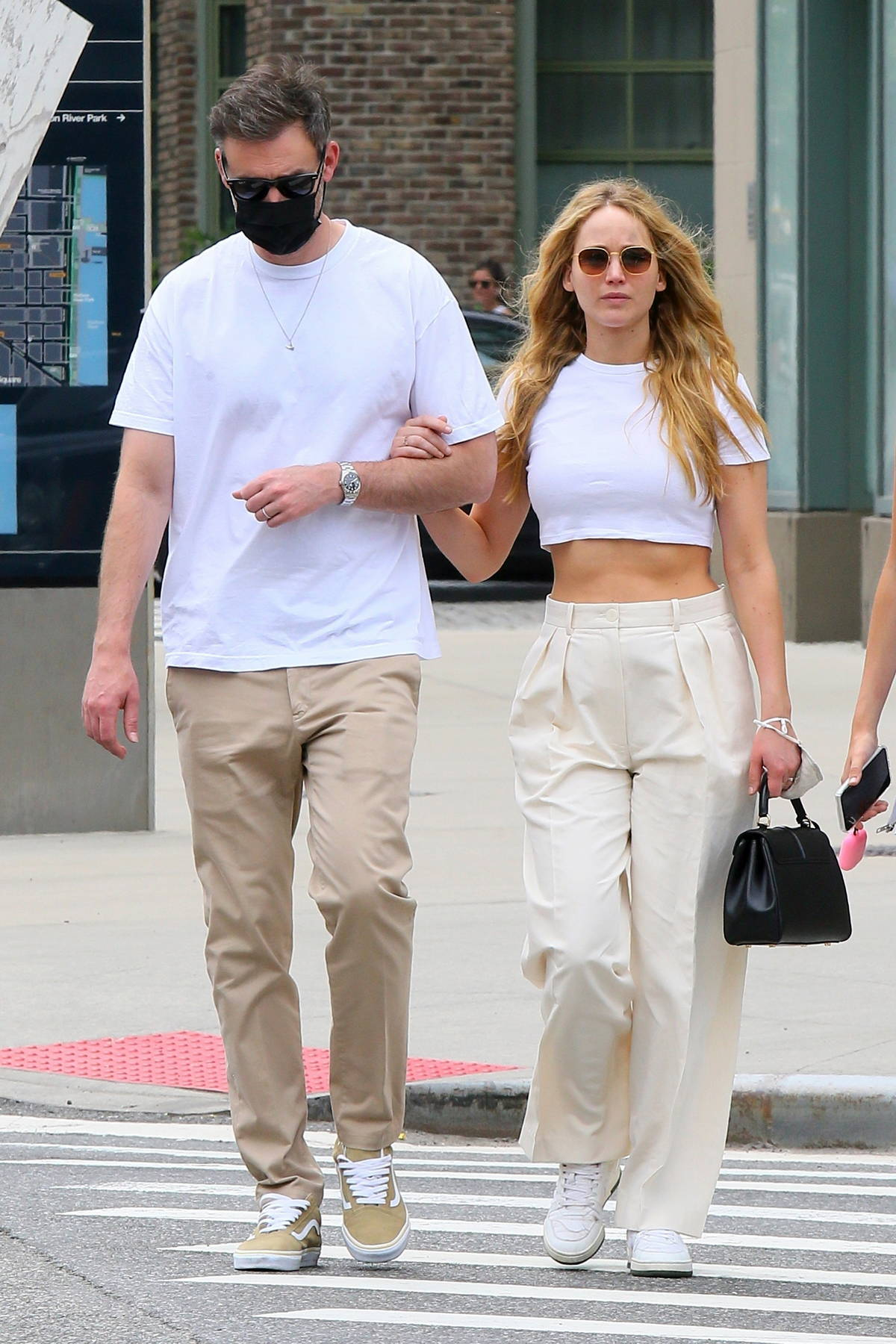 Jennifer Lawrence and Cooke Maroney walk arm in arm donning matching outfit during a lunch date in New York City