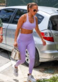 Jennifer Lopez displays her taut physique in purple sports bra and leggings as she arrives at the gym in Miami, Florida