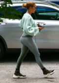 Jennifer Lopez sports silver leggings and a cropped sweater as she hits the gym in Miami, Florida