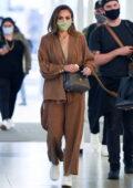 Jessica Alba and her husband Cash Warren seen arriving at JFK airport in New York City
