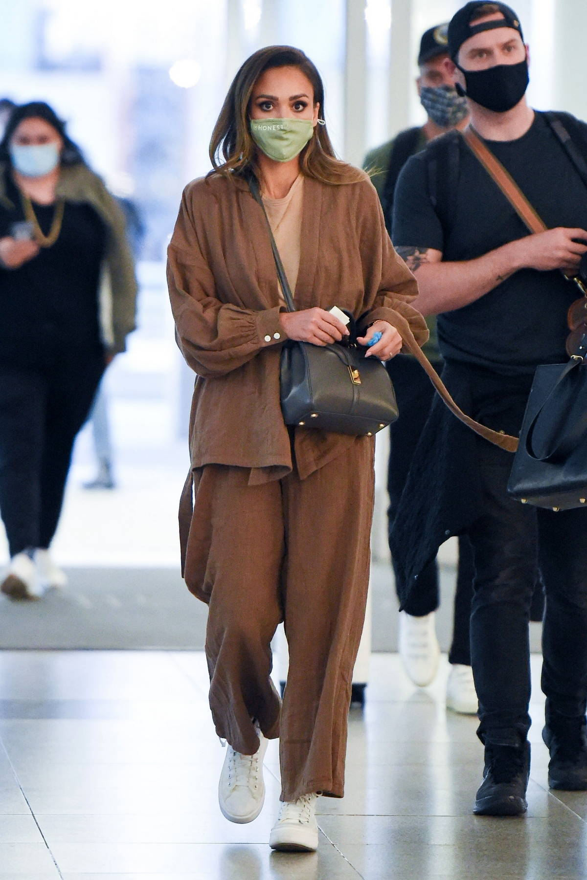 Jessica Alba and her husband Cash Warren seen arriving at JFK airport in New York City