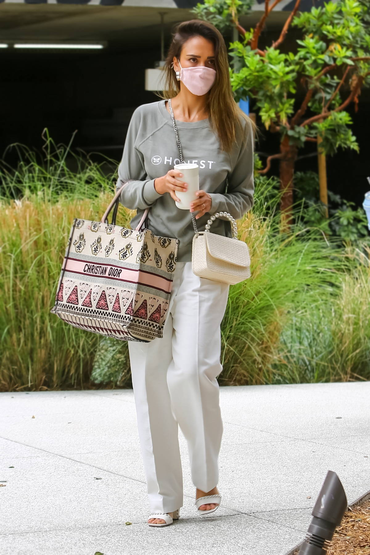 Jessica Alba arrives at her office wearing an Honest sweatshirt in Playa Vista, California