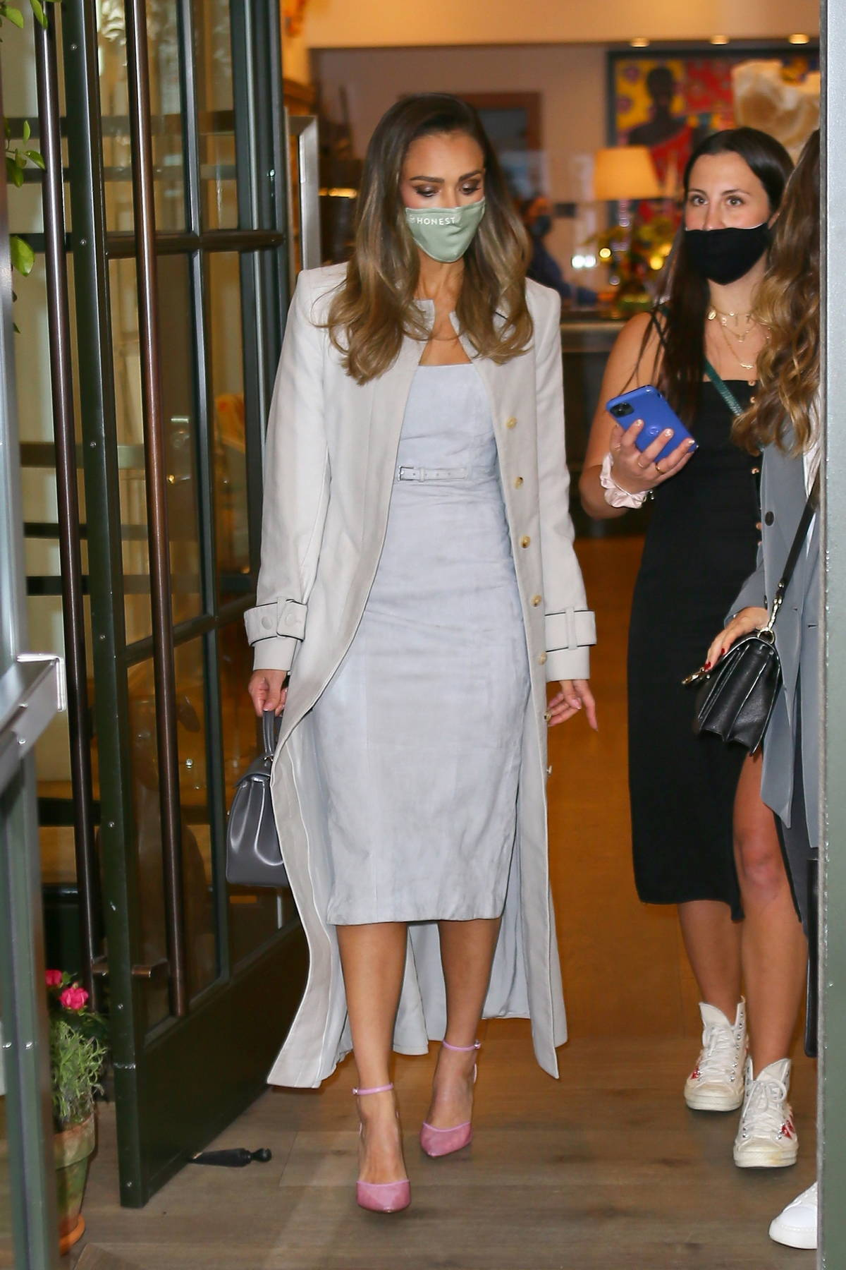 Jessica Alba looks elegant in a light blue dress with an off-white overcoat as she heads out in New York City
