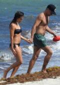 Jessica Alba slips into a dark blue bikini as she hits the beach with husband Cash Warren in Miami, Florida