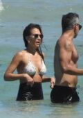 Jessica Alba wears a bikini top and legging shorts as she takes a dip into the ocean in Miami, Florida