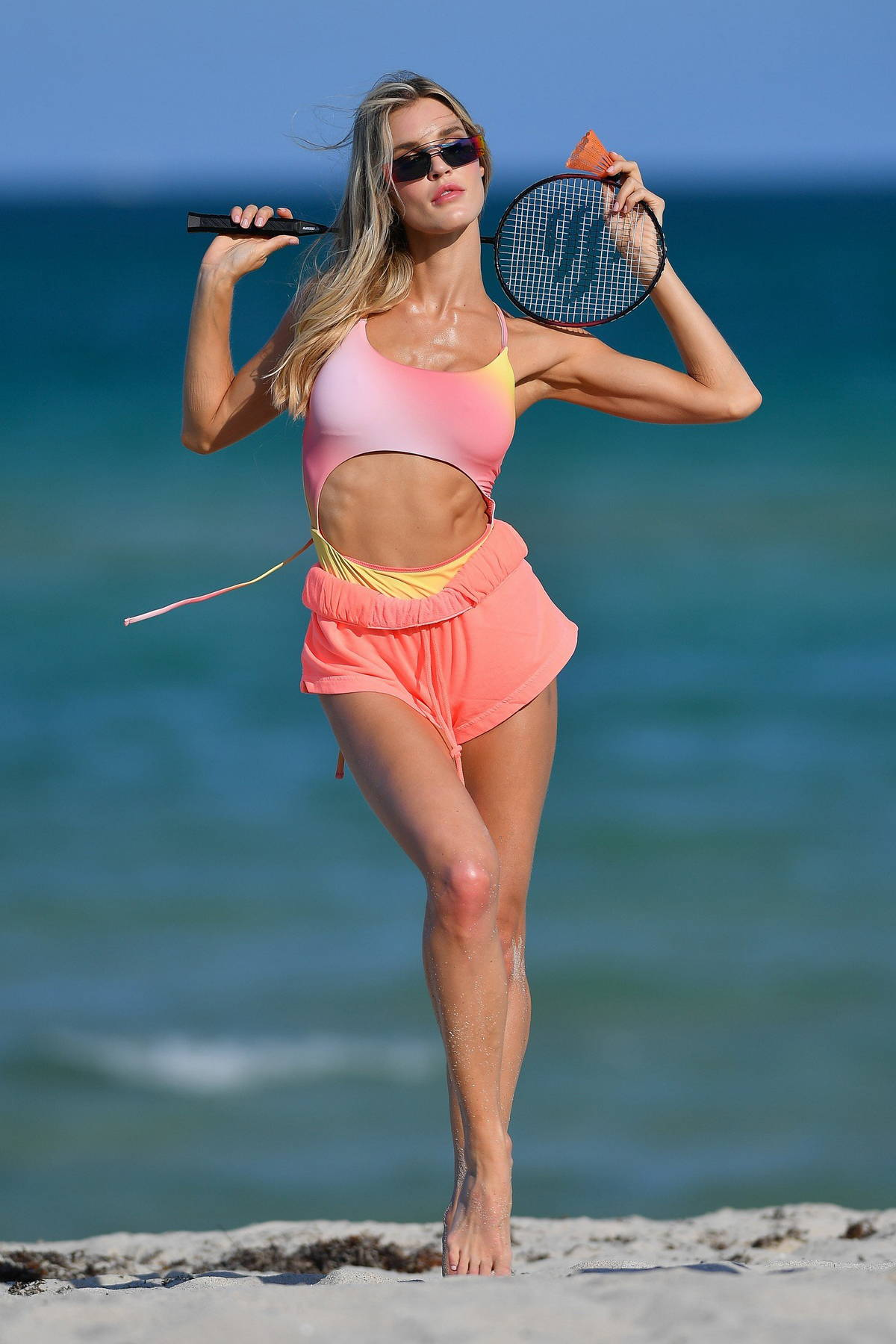 Joy Corrigan looks amazing in a tie-dye swimsuit and a pink bikini during a beach photoshoot in Miami Beach, Florida