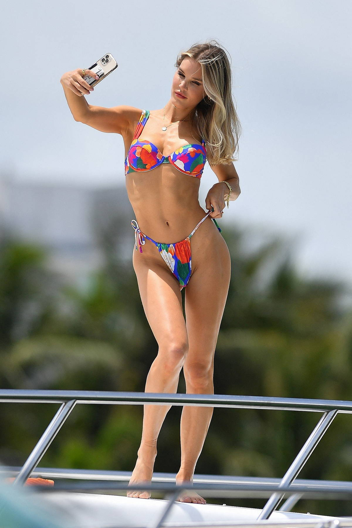 Joy Corrigan stuns in a colorful bikini while enjoying a day with friends on a yacht in Miami Beach, Florida