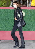 Kaia Gerber looks stylish in a leather jacket and black flare pants while leaving a late dinner at Matsuhisa in Beverly Hills, California