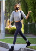 Kaia Gerber showcases her mile-long legs in heather grey leggings while leaving her Pilates class in West Hollywood, California