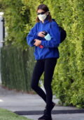 Kaia Gerber wears a blue hoodie and black leggings for her morning Pilates class in West Hollywood, California