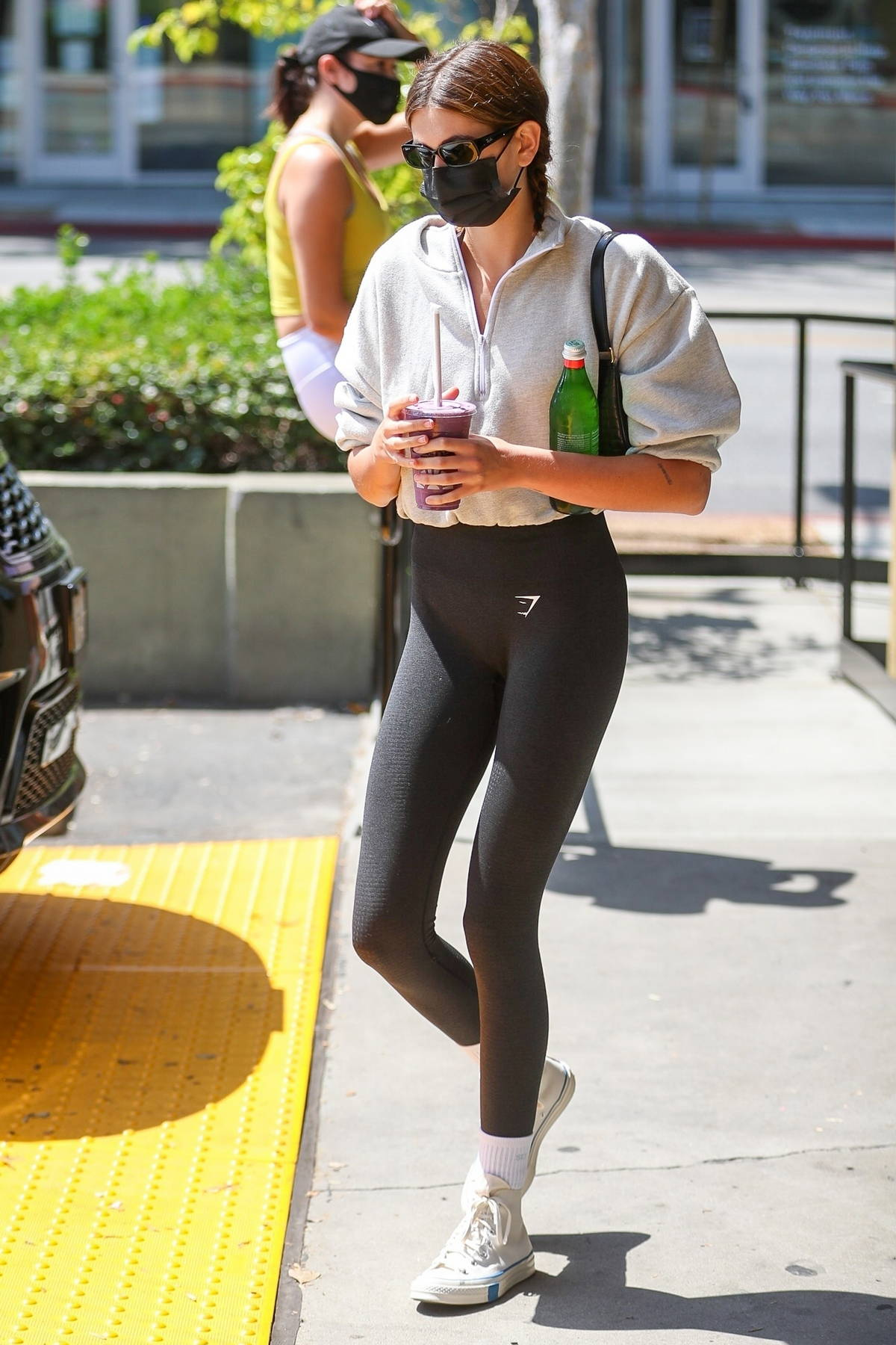 Kaia Gerber wears a cropped sweatshirt and leggings while picking up a smoothie at Earth Bar in Los Angeles