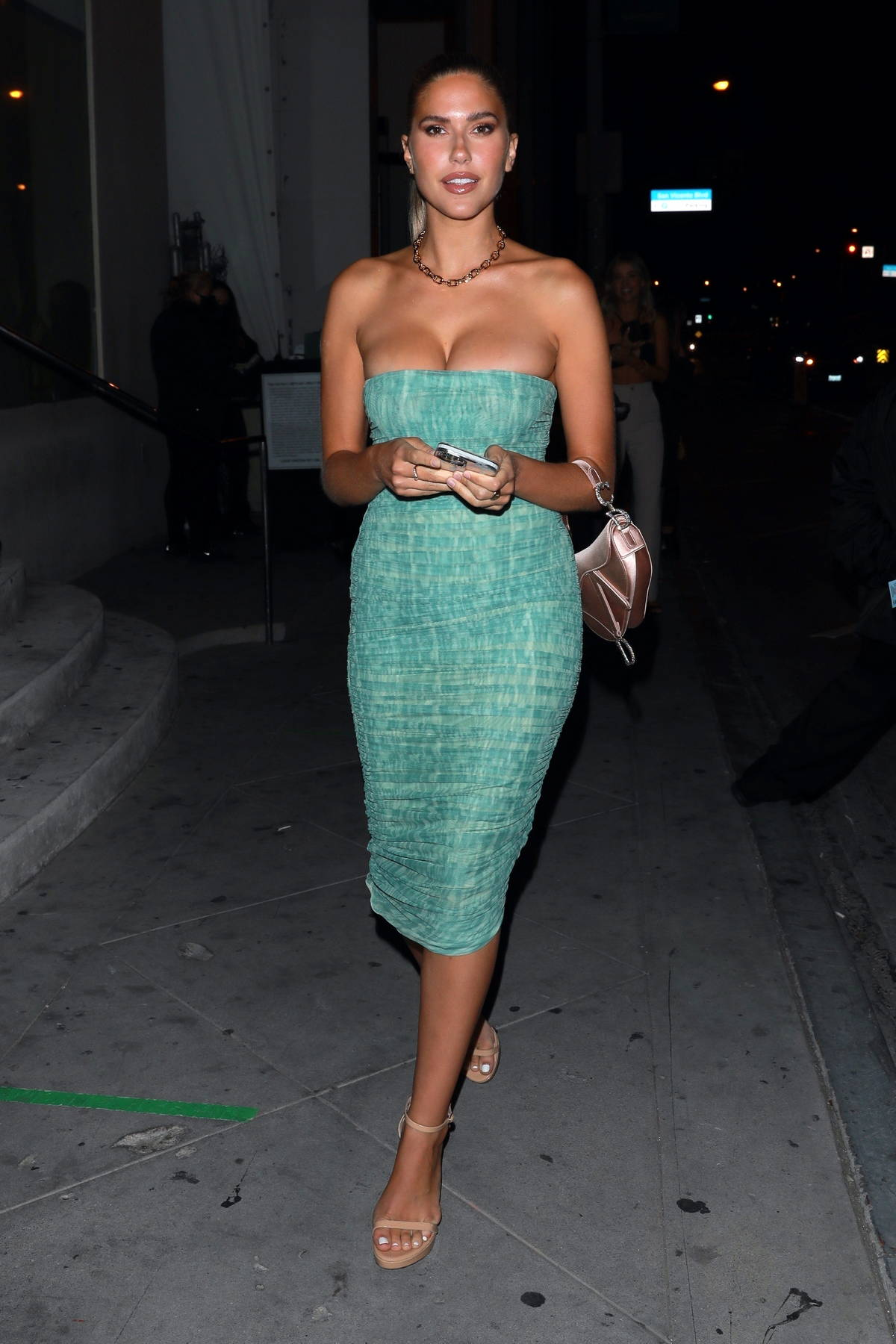Kara Del Toro looks stunning in a form-fitting strapless green dress while out for dinner at Catch in West Hollywood, California