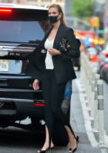 Karlie Kloss cuts a stylish figure in black Valentino blazer with a white top as she steps out in New York City