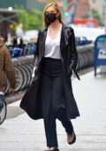 Karlie Kloss looks stylish in a leather trench coat, a white shirt and black trousers while out for stroll in New York City