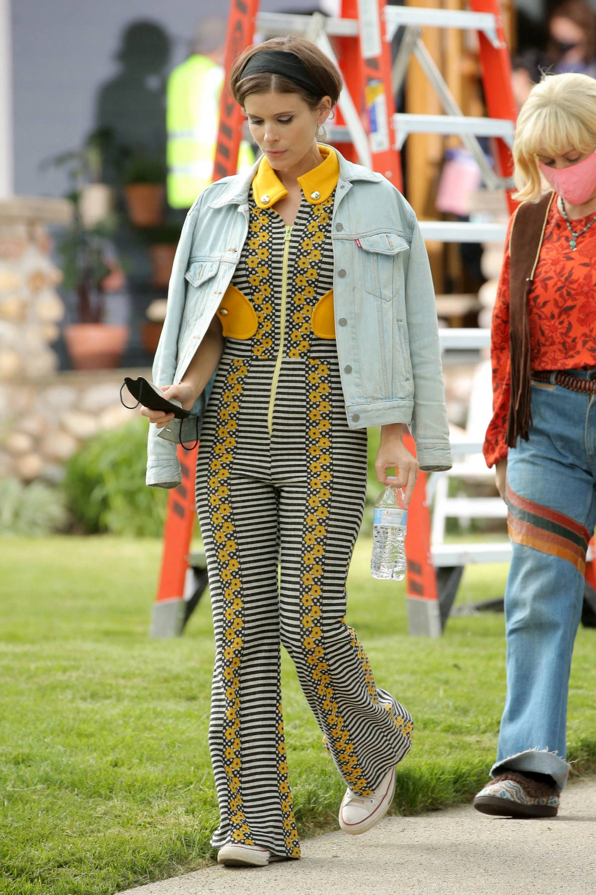 Kate Mara seen wearing a retro-style jumpsuit with platform high heels on the set of 'Call Jane' in Hartford, Connecticut