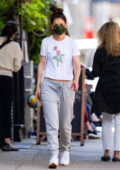Katie Holmes dresses down in a white tee and sweatpants as she steps out for a casual walk in New York City