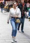 Kelly Brook is all smiles as she leaves Global Radio Studios in London, UK