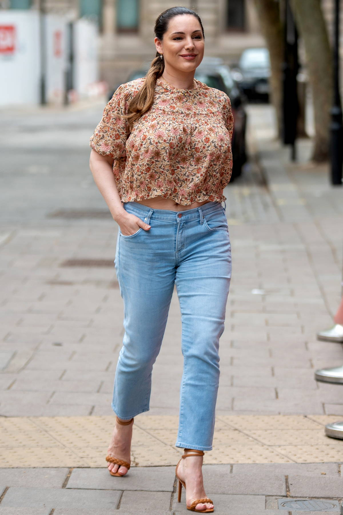 Kelly Brook looks pretty in a floral print top as she arrives at Global Radio Studios in London, UK