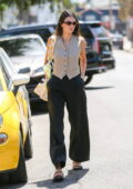 Kendall Jenner looks fab in a beige vest and black trousers while running a few errands with Fai Khadra in Los Angeles
