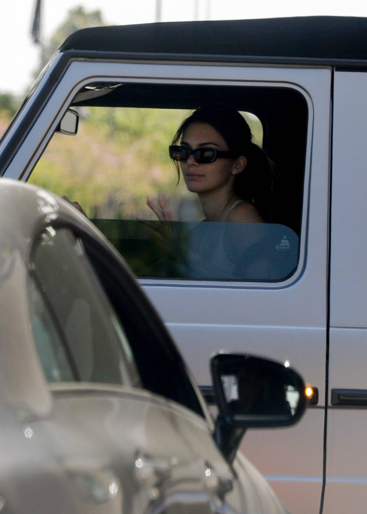 Kendall Jenner stops traffic in her convertible Mercedes G-Wagon while leaving the gym in Beverly Hills, California