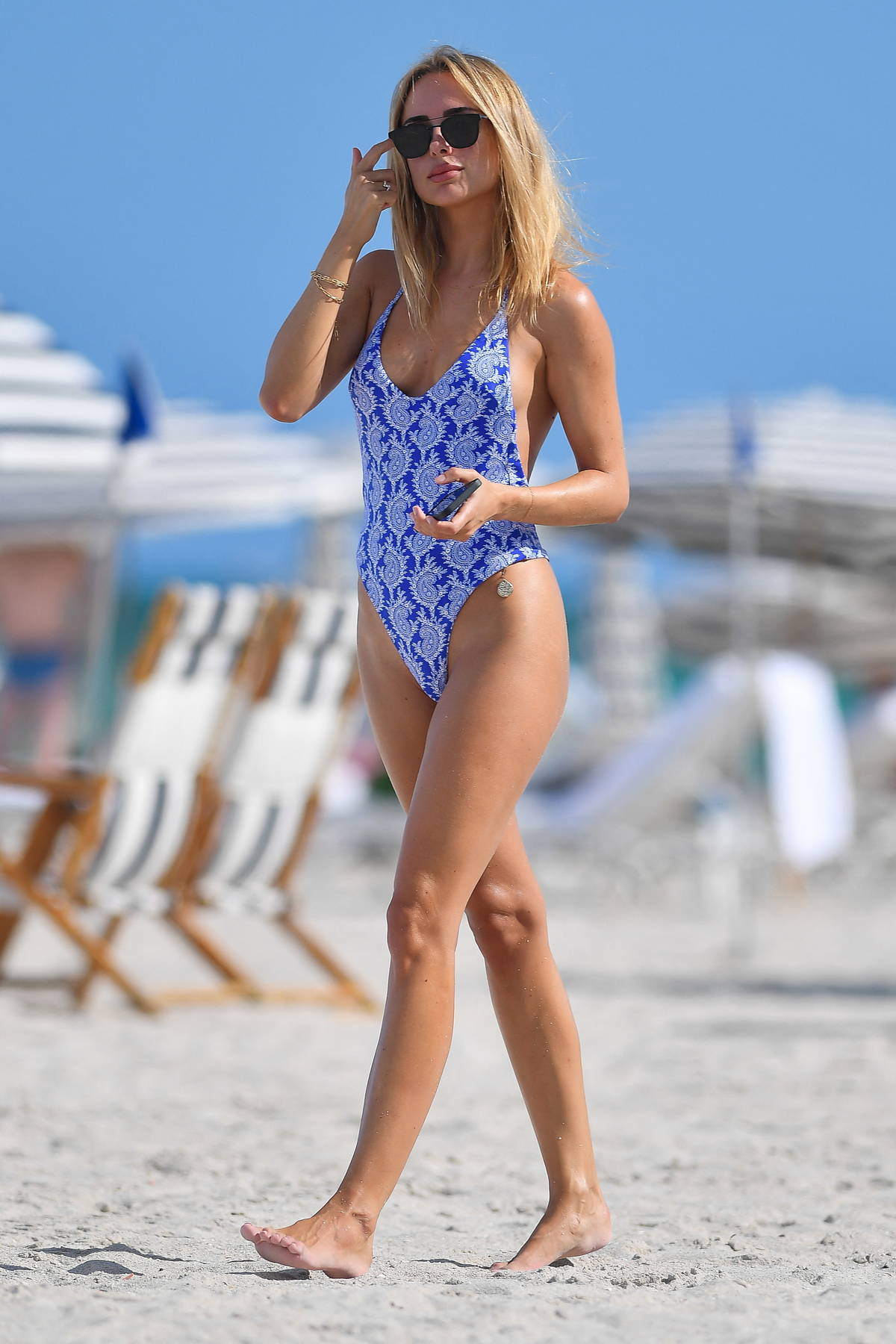 Kimberley Garner shows off her perfectly toned figure in a patterned blue swimsuit while enjoying the beach in Miami, Florida