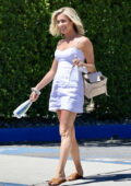 Kristin Cavallari looks radiant in a white mini dress as she wraps up a photoshoot in Palm Springs, California