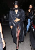 Kylie Jenner covers up in a black leather trench coat as she leaves the Nice Guy in West Hollywood, California