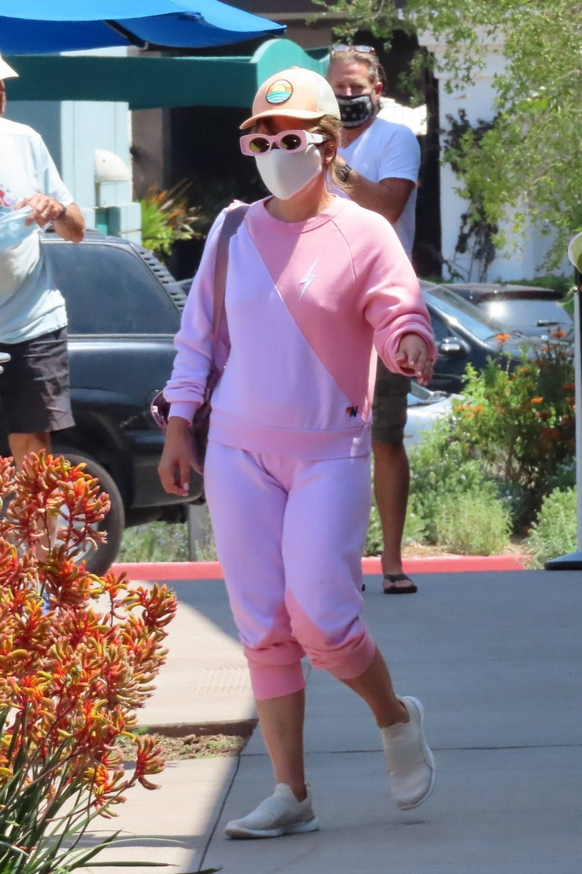 Lady Gaga goes incognito in a pink sweatsuit while out to grab lunch with her assistant in Malibu, California