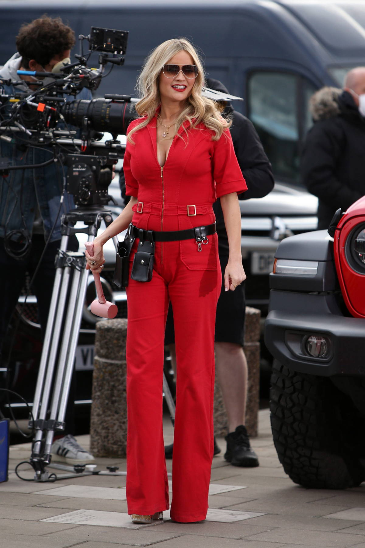 Laura Whitmore looks striking in a red jumpsuit while filming Love Island 2021 in Barking, East London, UK