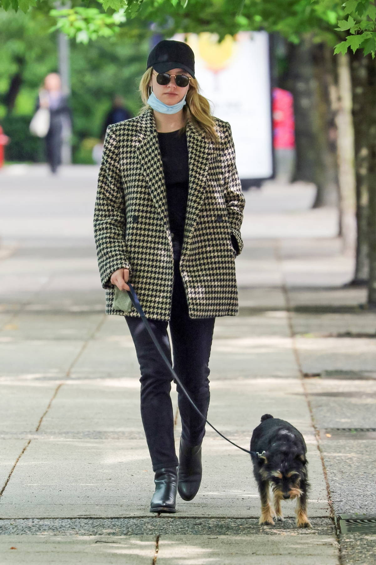 Lili Reinhart dons a houndstooth coat while walking her dog in Vancouver, California