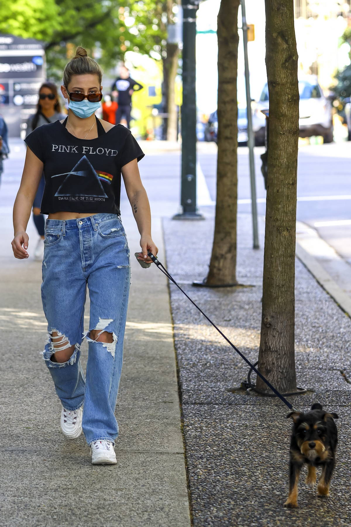 Lili Reinhart wears 'Pink Floyd' tee and ripped jeans while walking her pooch in Vancouver, Canada