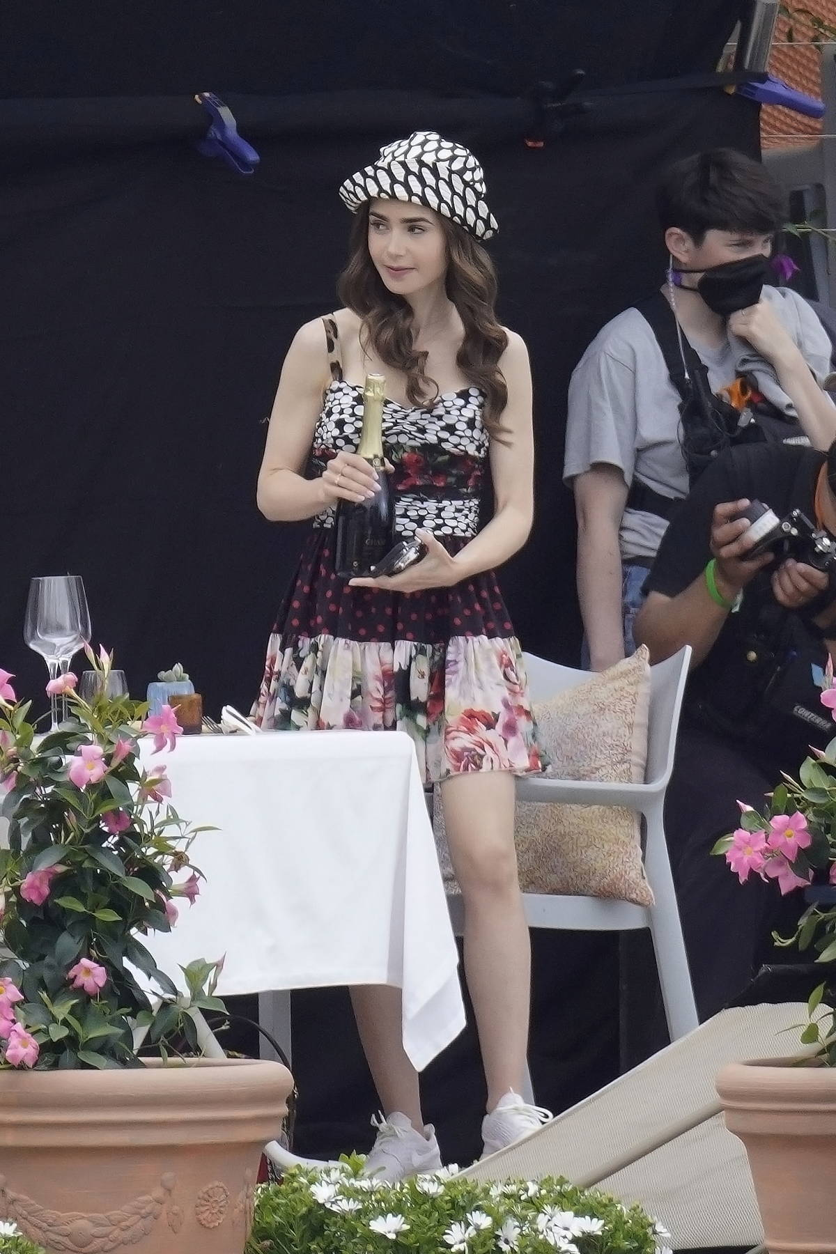 Lily Collins looks cute in multiple stylish dresses while filming on the set of 'Emily in Paris' in Paris, France