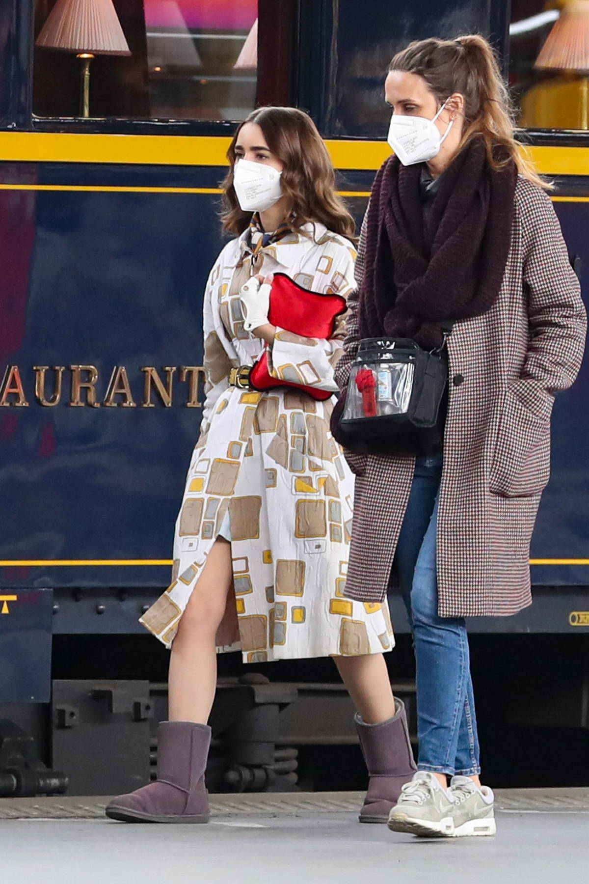 Lily Collins seen filming for 'Emily in Paris' at at Gare de l'Est train station in Paris, France