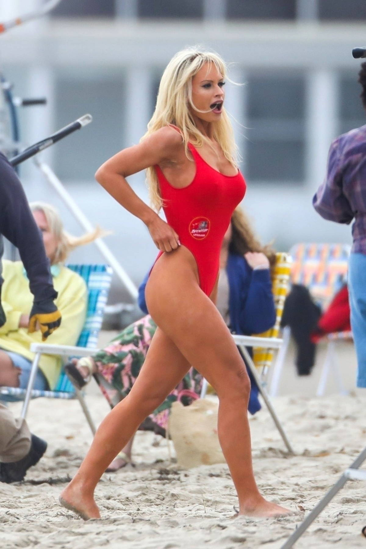 Lily James seen wearing the iconic red swimsuit while filming on the beach for 'Pam and Tommy' in Malibu, California
