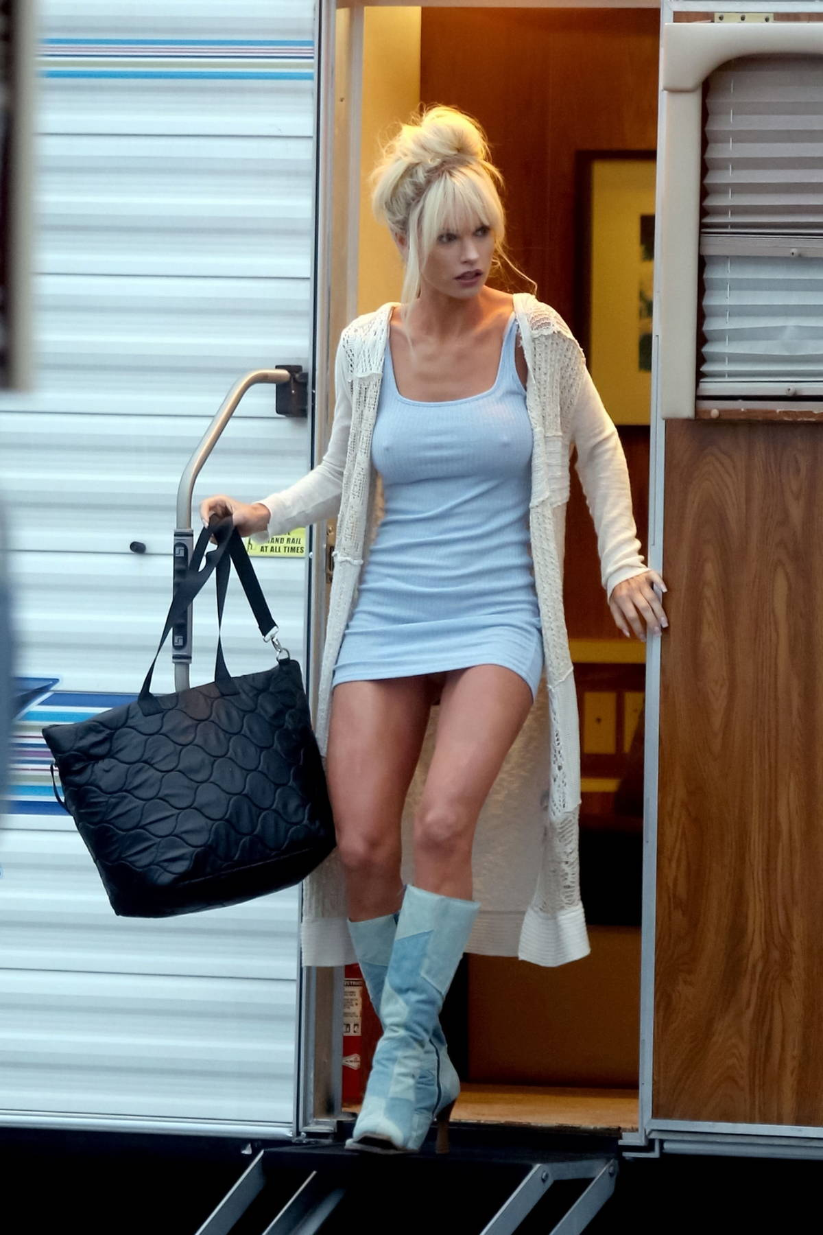 Lily James spotted in a form-fitting blue mini dress on the set of 'Pam and Tommy' in Malibu, California