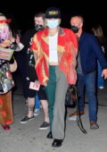 Miley Cyrus dons split-tone trousers and colorful jacket as she arrives at The Bowery Hotel in New York City