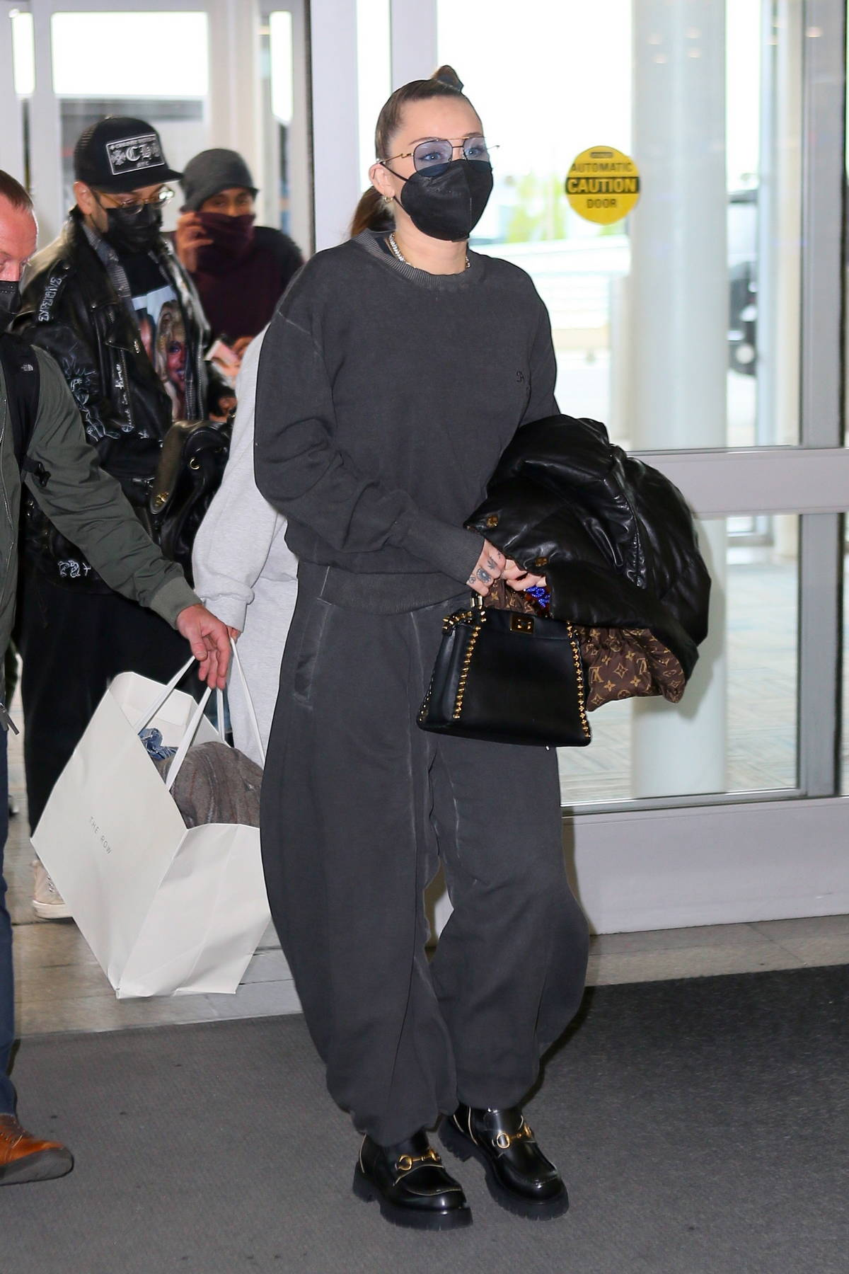 Miley Cyrus keeps it casual yet trendy in all-black while arriving at the JFK Airport in New York City