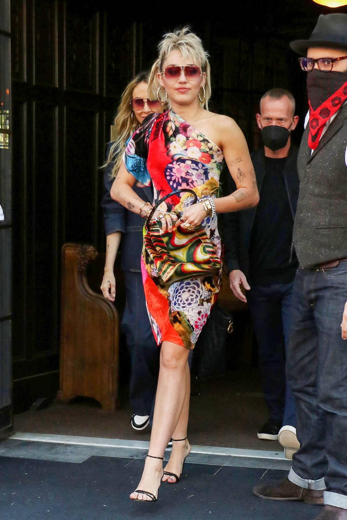 Miley Cyrus looks striking in a colorful dress as she heads out to rehearse for SNL in New York City